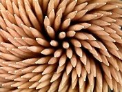 A close up shot of a wooden toothpicks on white