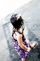 Girl playing on the street