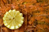 lemon on a salmon dish at an aperitive at an italian wedding