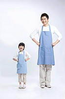 Father and daughter in apron