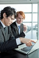 Two businessmen working with laptop