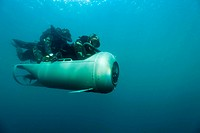 Military diver training. Military divers, or frogmen, training with a DPD Diver Propulsion Device. This device can carry two wet combat swimmers plus ...