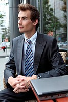 young caucasian businessman using his laptop in cafe