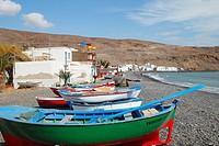 Fishing boats on beach at Pozo Negro on Fuerteventura, Canary Islands, Spain