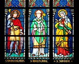 Stained Glass Window depicting from left to right St. Wenceslaus holding a cane and a shield, St Wolfgang holding a cane and a book, and St Joanna hol...