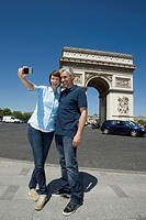 Mature Couple taking photograph of themselves