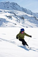 Children skiing on snowy mountainside