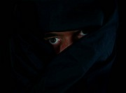 Scary Eyes Behind Black Cloak
