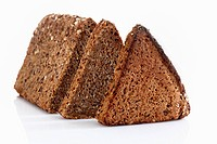 Multigrain rye bread loaf with slice on white background, close up