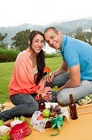 Hispanic couple having picnic together