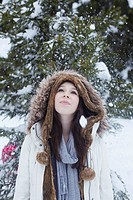 Teenage girl standing in snow