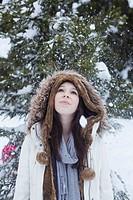 Teenage girl standing in snow