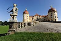 Sandstone statue blowing a hunter's horn, Jaegerturm und Amtsturm towers, Schloss Moritzburg Castle, Saxony, Germany, Europe