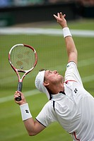 England, London, Wimbledon. Lleyton Hewitt AUS serving in a match at the 2011 Wimbledon Tennis Championships.