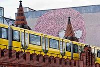 Suburban Train with a Graffiti in the background, Oberbaum Bridge, Friedrichshain, Berlin, Germany