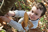 Boy in nature in autumn hues