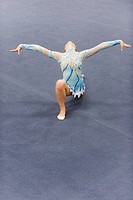 Female gymnast performing floor routine