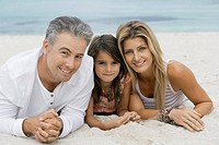 Family lying on beach, portrait