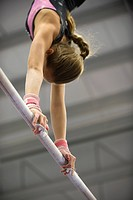 Female gymnast on horizontal bar