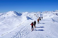 Group of people backcountry skiing ascending the mountain, Villgraten range in the background, Marchkinkele, Villgraten range, Hohe Tauern range, East...