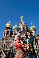 Couple in historic costumes pose as Empress and Tsar in front of Church of the Savior on Spilled Blood, Church of the Resurrection, St. Petersburg, Ru...