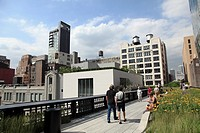 Visitors walking on the High Line Park a linear park built on a section of former elevated New York Central Railroad which runs along the lower west s...