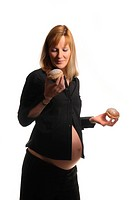 Picture of a young pregnant woman holding donuts in her hands