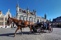 Grote Markt square with Stadhuis, city hall, and a horse-drawn carriage, old town of Bruges, UNESCO World Heritage Site, West Flanders, Flemish Region...