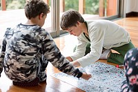 Hispanic boys playing board game