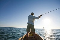 Man Casting Fishing Rod From Boat, Florida Keys, USA