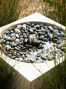 Modern pebble_filled water fountain
