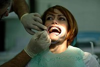 Patient is having a brace fitted at the dentist's