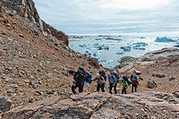 Group of hikers, Ammassalik Peninsula, at Sermilik Fjord, East Greenland, Greenland