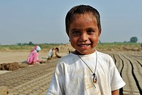 Smiling boy in a brick factory, most of the workers belong to the Christian minority in Pakistan and are particularly affected by discrimination and p...