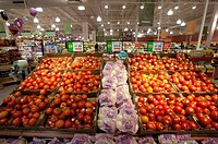 Produce section and tomatoes in grocery store