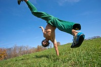 One arm handstand in field