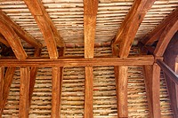 structural wood roof of the entrance of an old church