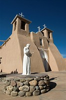 Statue of St. Francis of Assisi, Old Mission of St. Francis de Assisi, built about 1710, Ranchos de Taos, New Mexico, United States of America, North ...