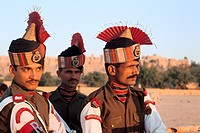 Soldiers belonging to the Border Security Force in ceremonial dress  In the background, the fort of Jaisalmer  From Rajasthan, India