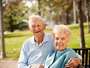 Portrait of senior couple on park bench
