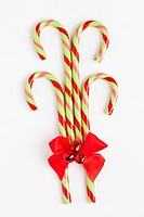 Striped candy canes with red ribbon, studio shot
