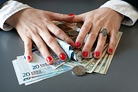 young woman hands counting euros and dollars