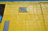 Yellow Foam Insulation On The Outside Wall Of An Industrial Building, Quebec Canada