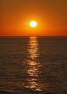 sunrise over malaga bay seen from torremolinos, torremolinos, costa del sol, malaga province, spain
