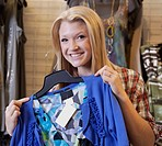 a young woman shopping for clothing at a boutique, edmonton, alberta, canada