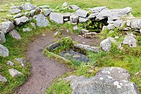 water trough at the drombeg recumbent stone circle near glandore, county cork ireland