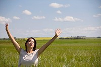 woman in a field with raised hands, three hills alberta canada