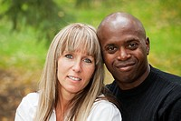 portrait of an interracial couple in a park, edmonton alberta canada