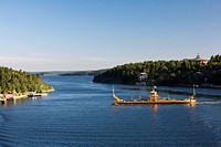 a barge crossing the entrance of the fjord, stockholm, sweden