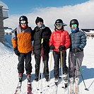 four skiers ready to go at a ski resort, whistler british columbia canada